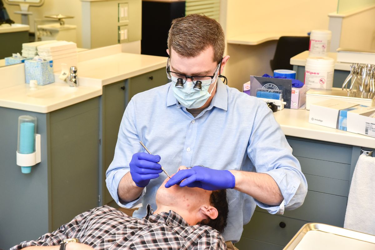 Dr. Brady working on a patient's teeth